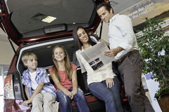 Low Angle View Of Family Sitting At Back Of Car Stock Photography