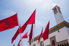 Free Low Angle View Of Moroccan Flags And A Clock Tower - Casablanca Royalty Free Stock Photo - 97155265