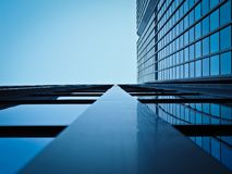 Low Angle View of Office Building Against Clear Sky Stock Photo