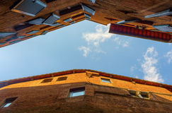 Low angle view of old buildings in Siena Stock Photos