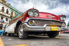Low angle view of an old red Chevrolet in Havana Royalty Free Stock Images