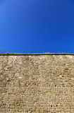 Acco Wall. Low angle view of part of a stone wall, located at the old city of Acco, Israel Stock Image