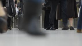 Low angle view of people walking in a railway station. Low angle view of people walking on the side of the underground railway in London stock footage