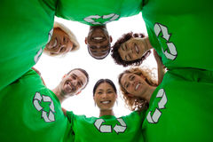 Low angle view of people wearing green shirt with recycling symb Royalty Free Stock Photography