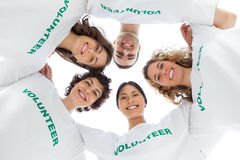 Low angle view of people wearing volunteer tshirt Royalty Free Stock Photography