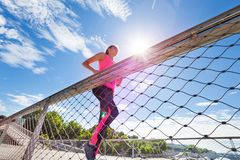 Active woman working out jogging at racetrack Royalty Free Stock Image