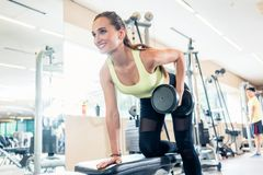 Low-angle view portrait of a beautiful fit woman smiling while exercising stock photos