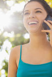 Low angle view of pretty woman being on the phone Royalty Free Stock Images