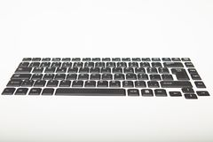 Low angle view of a qwerty computer keyboard. Low angle view of a qwerty alphanumeric computer keyboard with black keys on silver gradient to white with copy stock photos