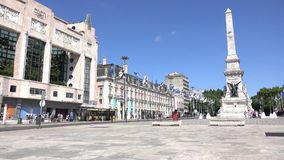 Low angle view of Restauradores Square. Typical scene for visitors to Restauradores Square in Lisbon Portugal stock footage