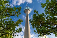 Low-angle view of the Rhine Tower in Dusseldorf against a cloudy blue sky Royalty Free Stock Photography