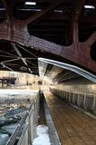 Low-angle view of a riverwalk alongside frozen Chicago River in January Stock Images