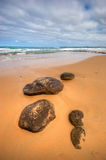 Low angle view of rocks on beach at Phillip Island Stock Images