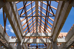 Low angle view of roof trusses and framing wooden of new house c Royalty Free Stock Photo