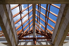Low angle view of roof trusses and framing wooden of new house c Royalty Free Stock Photos