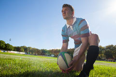 Low angle view of rugby player getting ready to kick for goal Stock Photos