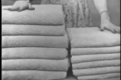 Low angle view of saleswoman selling towels stock footage