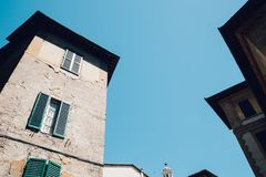 Low angle view of Siena old buildings in Italy. Low angle view of Siena old town buildings in Italy Stock Photo