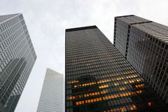 A low angle view of skyscrapers in New York City in a cloudy day royalty free stock photo