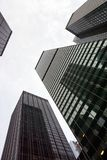 A low angle view of skyscrapers in New York City in a cloudy day royalty free stock photography