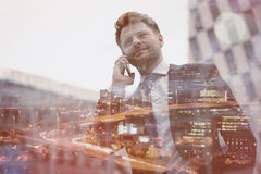 Low angle view of smart businessman talking on mobile phone Royalty Free Stock Photos