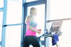 Low angle view of sporty blonde woman exercising on treadmill Royalty Free Stock Photography