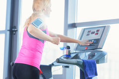 Low angle view of sporty blonde woman exercising on treadmill Royalty Free Stock Images