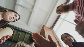 Low angle view of start-up business team of multi-ethnic people put palms together after successful agreement about new. Low angle view of start-up business team stock video