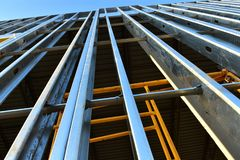 Upward growth of new steel frame commercial building. royalty free stock photography