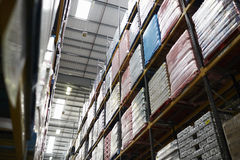 Low angle view of stock stored in a distribution warehouse Royalty Free Stock Image
