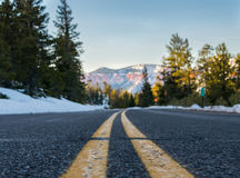 Low Angle View of Stripe on Snowy Mountain Road. Low Angle View of Stripes on Snowy Mountain Road Royalty Free Stock Photo