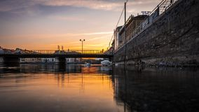 Low angle view of the sun setting on the river Rhone. royalty free stock photography
