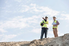 Low angle view of supervisors discussing at construction site against sky Royalty Free Stock Photography