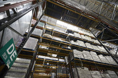 Low angle view of tall shelving racks at a warehouse stock photo