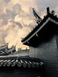Low angle view of temple entrance against sky / Low chroma image stock photos