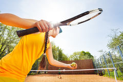 Low angle view of tennis player against blue sky Stock Photo
