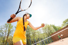 Low angle view of tennis player preparing to serve Royalty Free Stock Photography