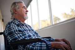 Low angle view of thoughtful senior man sitting on wheelchair Stock Images