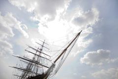 Low angle view of three masted ship against cloudy sky Royalty Free Stock Photo