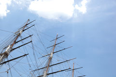Low angle view of three masted ship against sky Stock Photography