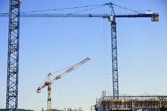 Cranes at Construction Site Royalty Free Stock Images