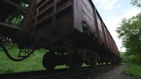 A low angle view of train cars passing along a track Low Angle View of Train A low angle view of train cars passing. Along a track stock video