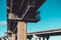 Low angle view underneath Throgs Neck Bridge with high contrast and shadows. On sunny day in Beechhurst, Queens, NY stock photography