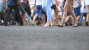 Low angle view of unrecognizable pedestrians crossing intersection in big city at summer day. Crowd of people walking a. Crosswalk in downtown. Concept of urban stock video