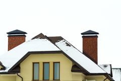 Low angle view of the upper floors of a new large house. Window and roof detail of residential home building. Real estate property.  Stock Photos