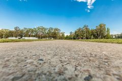Low angle view of walkway leading into the distance with trees. Low angle view of walkway leading into the distance with trees Royalty Free Stock Photo