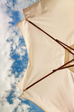 Low angle view of white beach umbrella Stock Photo