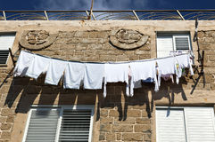 White Laundry Drying on the Clothline Stock Photography