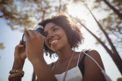 Low angle view of woman photographing Stock Photo