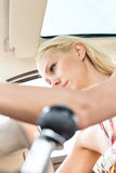 Low angle view of woman sitting in car. Low angle view of women sitting in car Stock Photos